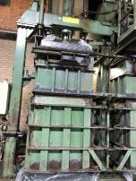 massive pressing machine to make wool bales